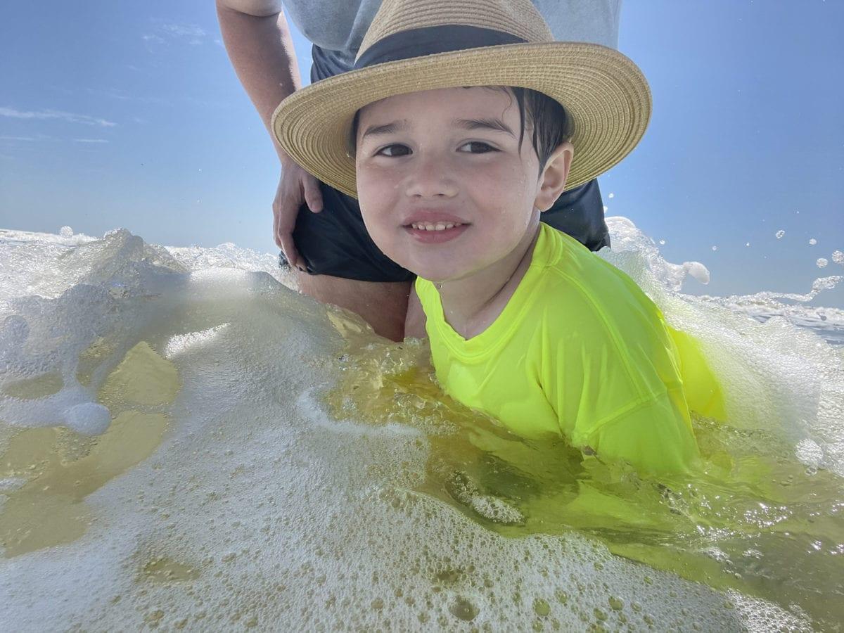 Young Boy Enjoying the Ocean