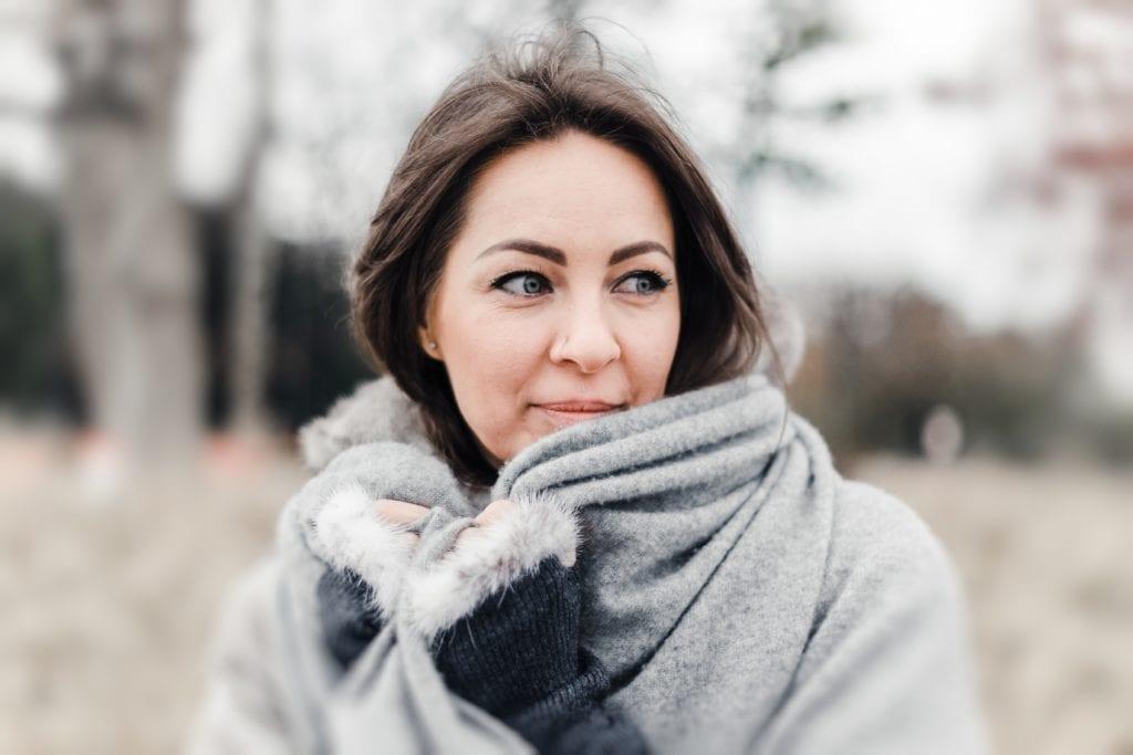 Woman wearing grey top