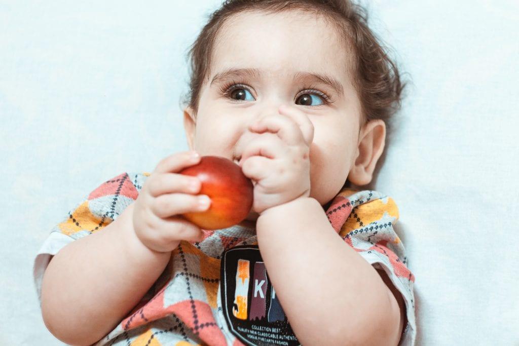 sourena , cute brown boy , little kid eating peach